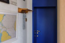 02 This is an entrance door done in bold blue with gold leaf and the whole wall is covered with posters