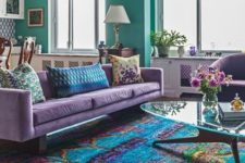 02 a bright open layout with colorful furniture with a bright printed rug and bold walls