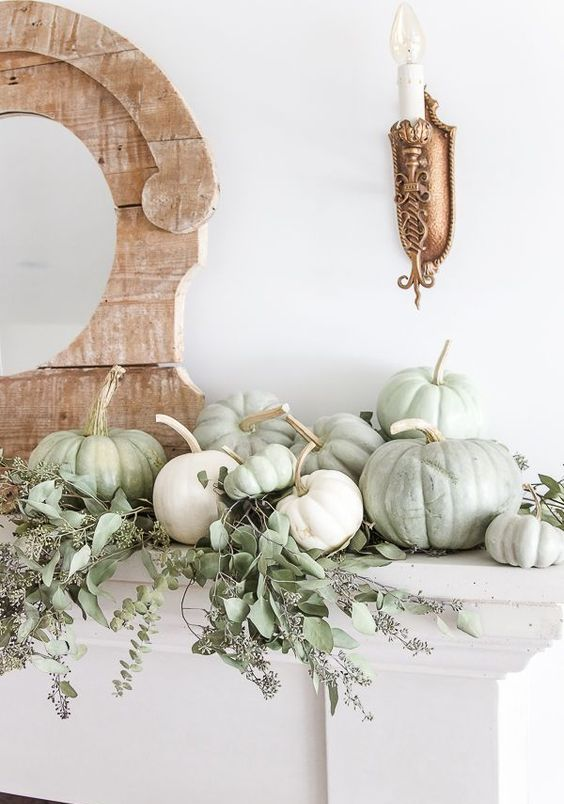 a fresh natural mantel with eucalyptus and heirloom pumpkins for a beautiful Thanksgiving mantel