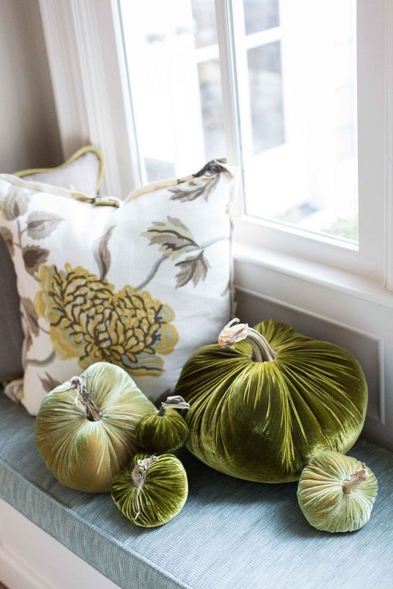 an arrangement of rich green velvet pumpkins is a chic idea for fall and Thanksgiving decor and it will last long