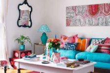 03 a bold living room with many printed textiles, pillows, artworks and chic furniture