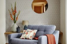 03 a chic mid-century modern nook with printed wallpaper and bright warm shades
