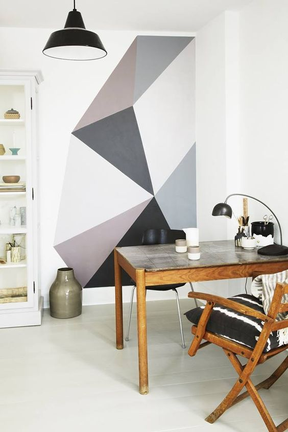 a cozy home office nook that is visually separated from the rest of the space with a geometric color block wall