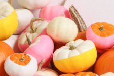 03 an arrangement of bright color block pumpkins can be stacked on a mantel or your dining table