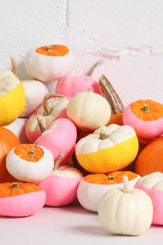 an arrangement of bright color block pumpkins can be stacked on a mantel or your dining table