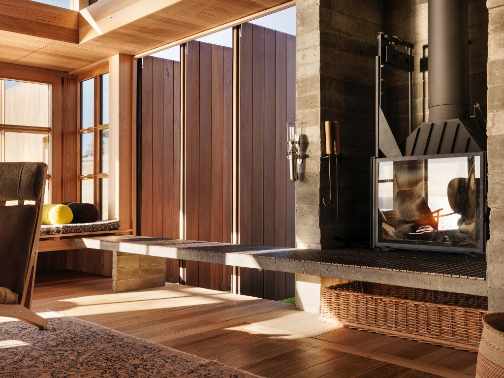 Look at the gorgeous hearth, it looks modern and vintage at the same time, and there are amazing views of the bay