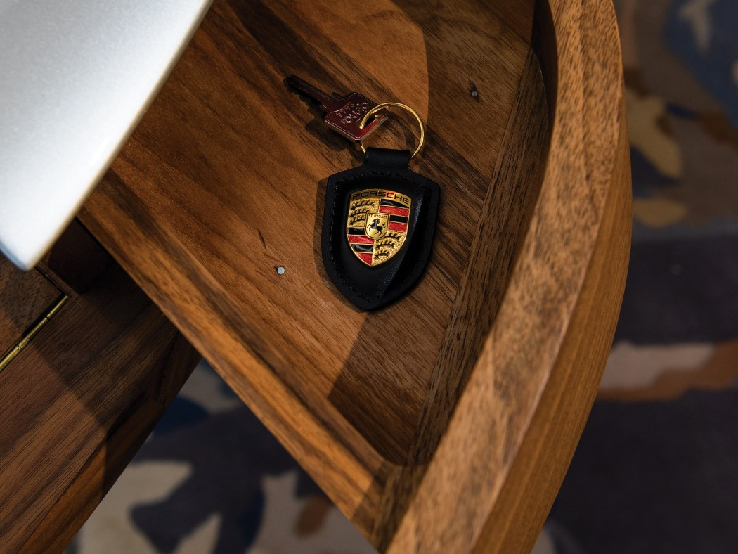There are drawers for storage, and the refined wood highlights the design