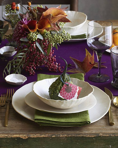 a bright purple table runner, green napkins and a super bright floral centerpiece to enjoy the colors