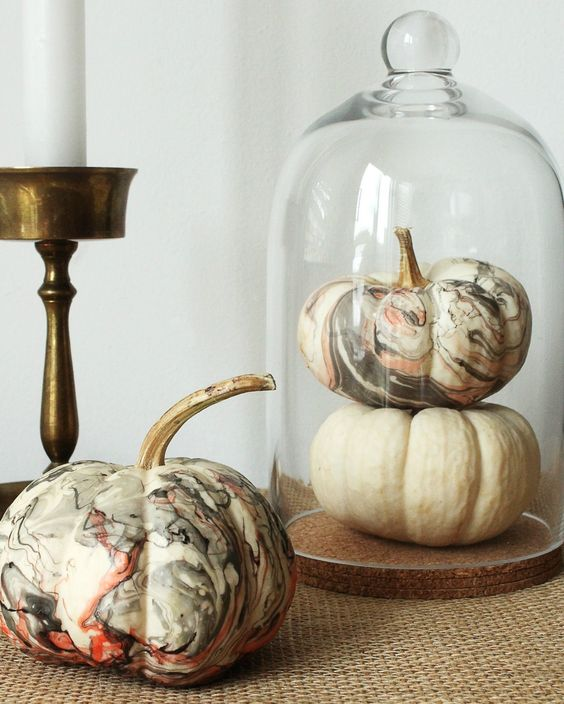 a cloche with a white and marbleized pumpkin is a fast and cute centerpiece you can make last minute