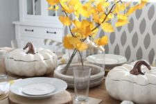 04 a cozy fall table setting with a fall leaf centerpiece, wood slice placemats and faux pumpkin salad bowls