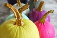 04 an arrangement of colorful pumpkins with glitter stems for an ultimate glam Halloween party