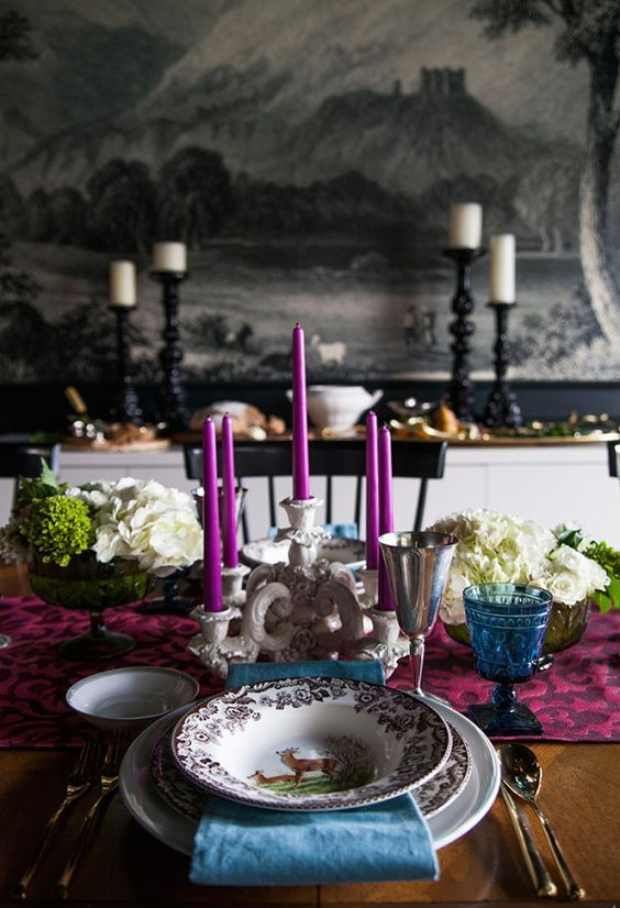 a bright Thanksgiving tablescape done with fuchsia and blue touches plus white hydrangeas and an elegant candelabra