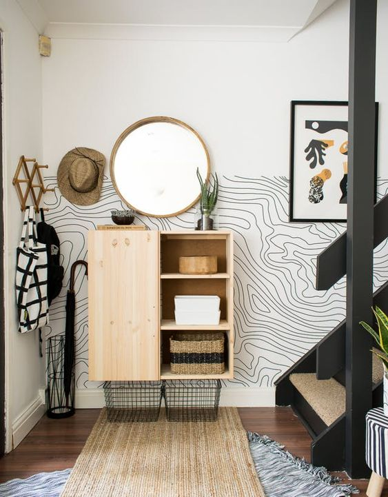 a peaceful Scandinavian space in neutrals with a cool and creative printed wallpaper wall for a catchy touch