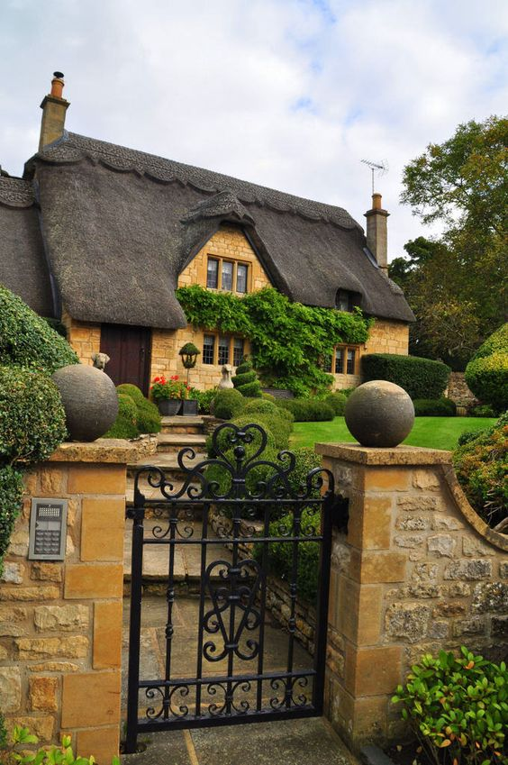 a thatched roof is a characteristic features of traditional English cottages, which is sure to make yours very vintage like