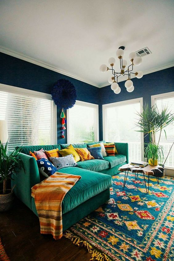 navy as a basic color, emerald and yellow touches plus mid-century modern furniture