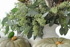 05 some heirloom pumpkins, seeded eucalyptus and feathers will make up a nice Thanksgiving display with a boho feel