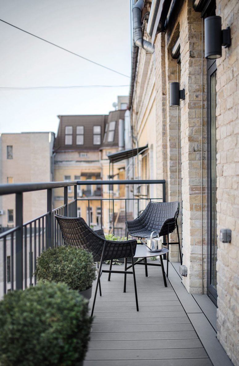 The small balcony features a little sitting space with a coffee table