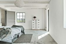 06 The spaces are neutral but don't look boring due to textures used – concrete, wood, yarn in decor