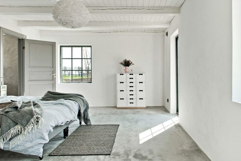 The spaces are neutral but don't look boring due to textures used - concrete, wood, yarn in decor