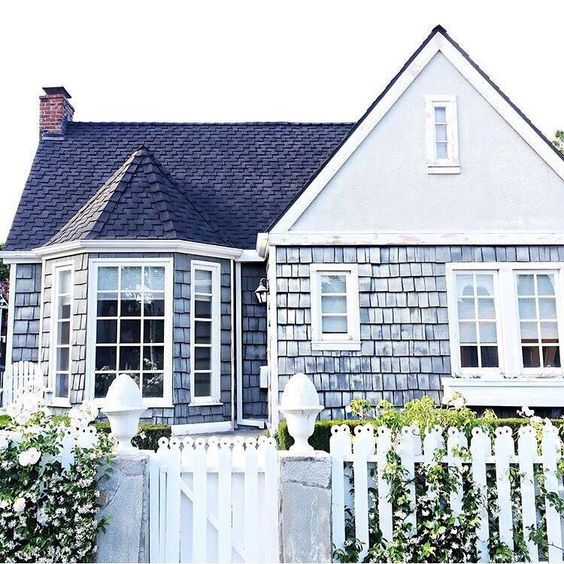 a beach cottage with shingles in a pale blue shade and a sweet garden is what you need