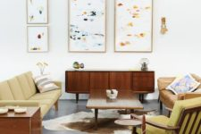 06 a bright mid-century modern living room with mustard colored furniture and abstract paintings