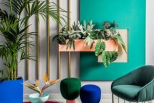 06 a super colorful space with jewel tone stools and colorful upholstered furniture plus a colorful accent wall