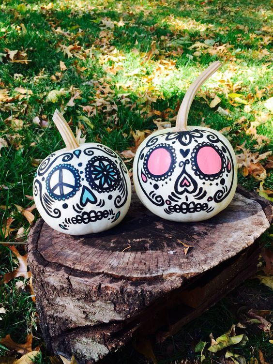 bright sugar skull inspired Halloween pumpkins decorated with usual sharpies