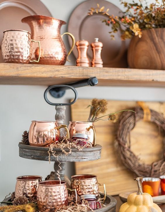 copper mugs and a pitcher are a great idea to create a chic Thanksgiving bar that invites