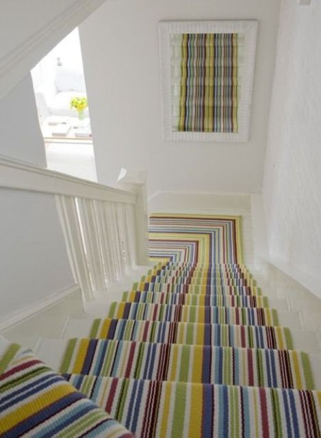 a colorful striped carpet is a simple and quick idea to make your staircase bright, colorful and fun