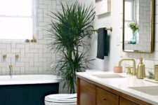 07 a welcoming mid-century modern bathroom with geometric clad tiles and penny ones on the floor plus a palm tree