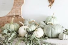 07 simple rustic mantel styling with white and green heirloom pumpkins and fresh eucalyptus for Thanksgiving