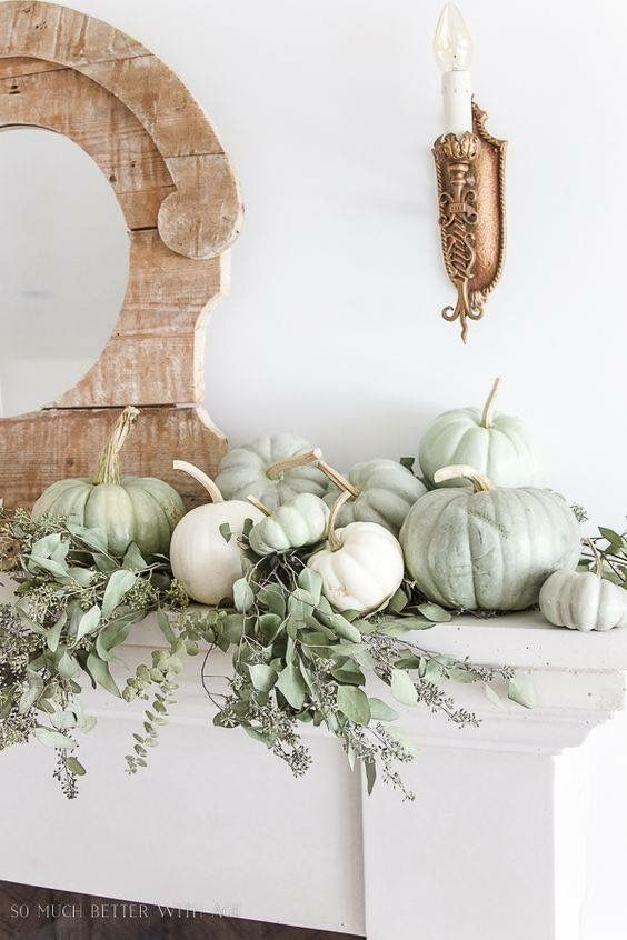 simple rustic mantel styling with white and green heirloom pumpkins and fresh eucalyptus for Thanksgiving