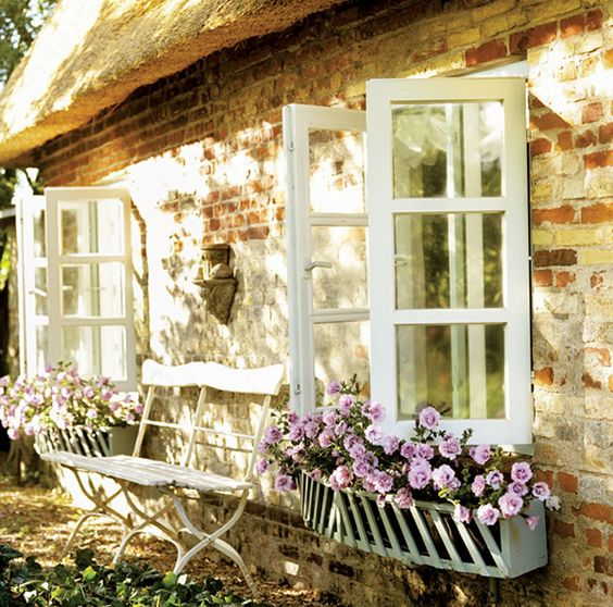 window boxes are traditional for cottages and you may easily change the look from season to season with them