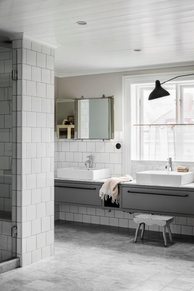 The large bathroom features two parts, a sink zone and a bathing one