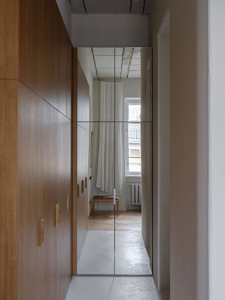 The storage is hidden in an elegant way, there's a closet next to the bedroom with enough light and mirrors