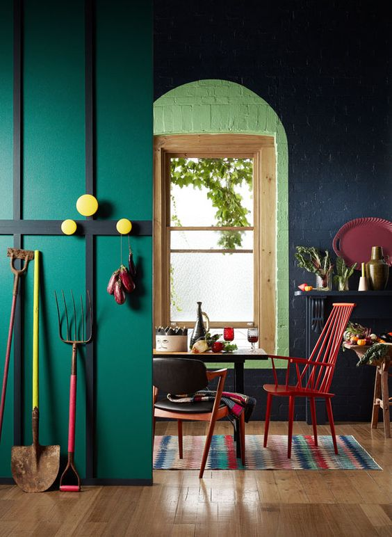 a bright space in emerald, black with red and yellow accens and a printed rug