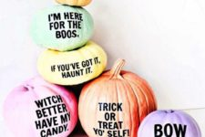 08 an arrangement of Halloween pumpkins with fun and quirky phrases on them for a modern touch