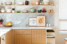08 an inviting mid-century modern kitchen with plywood cabinets, open shelving and bright porcelain