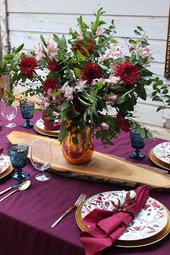 go for a fuchsia tablecloth and napkins, bright blooms and gilded cutlery for Thanksgiving and enjoy the color