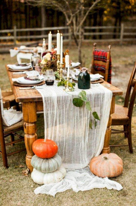 if you hestate about an airy table runner, just nail it with large heirloom pumpkins to make it secure on the table