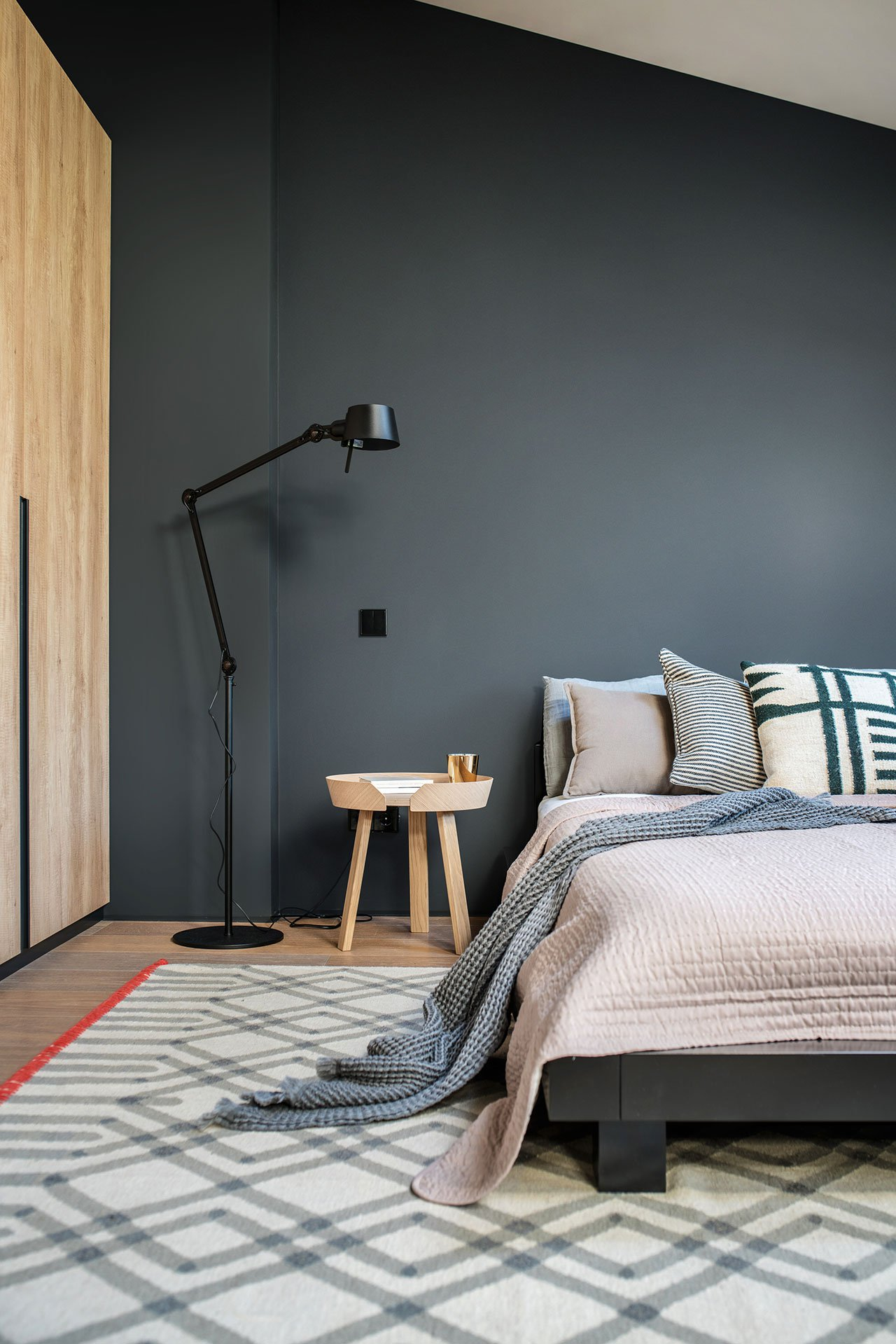 The guest bedroom is a comfy attic space with a large bed and a wardrobe, minimalist yet catchy furniture is great