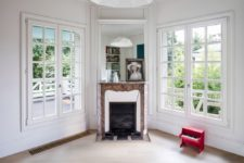09 The living room shows off a vintage fireplace and French windows