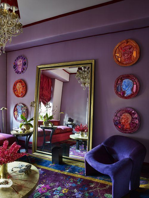 a bright boho space in purple, fuchsia, pink and blue and lots of gilded touches