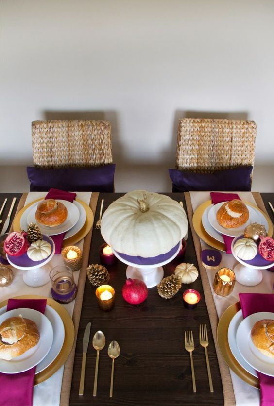 a colorful rustic tablescape with touches of purple, fuchsia and hot pink plus gold