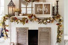 09 a fall leaf and pumpkins wreath and garland, candles and lanterns plus a rustic sign