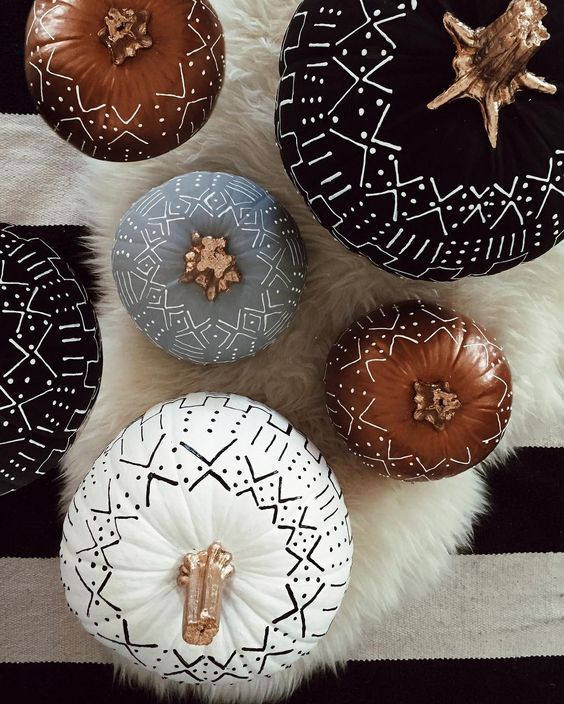 tribal pumpkins in black, white and rust decorated with a usual sharpie is a simple boho craft