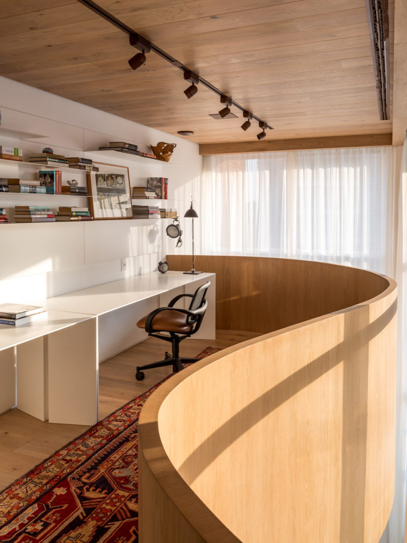 The inner balcony features a home office with comfy furniture and much light