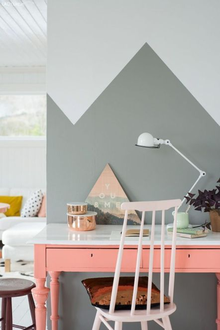 a home office nook with grey geometric color blocking and a coral desk for a colorful touch