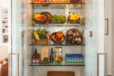 10 a large fridge with glass doors and glass shelves is a great extra display and it will make the kitchne fele more open