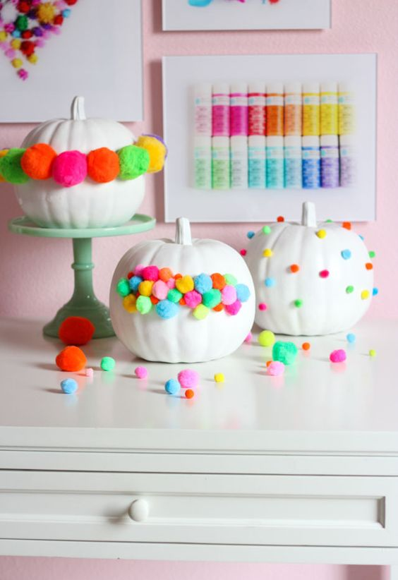 colorful pompom pumpkins are great for Halloween, fall and Thanksgiving parties in bold shades
